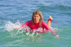 Surfer girl on the wave Royalty Free Stock Photography