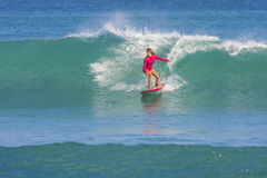 Surfer girl on the wave Stock Photo