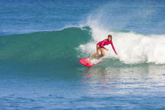 Surfer girl on the wave Stock Photos