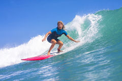 Surfer girl on the wave Royalty Free Stock Image