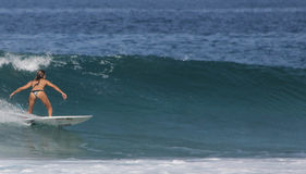 Surfer Girl 3. A young lady surfing in Puerto Escondido, Mexico Stock Image