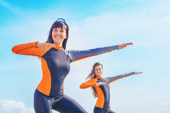Surfer girls in Bali. Practicing the correct position to stand on Royalty Free Stock Image