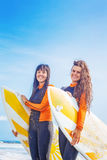 Surfer girls in Bali. Two surfer girls  walking on a beach Stock Images