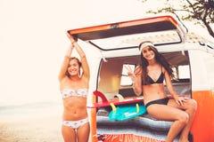Surfer Girls Beach Lifestyle Stock Image
