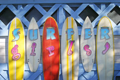 Surfer Girls Black and White. Surfer Girls - surfboards in Color as a sign Royalty Free Stock Image