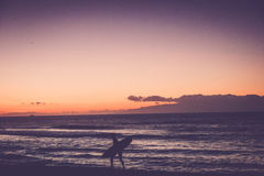 Surfer go home when finish Royalty Free Stock Photography