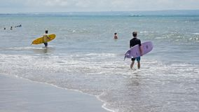 Surfer Going Into Water Bali Slowmotion stock footage
