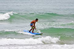 Surfer in green blue in the ocean wave, surfing. Indonesia, Bali, 10 November 2011. Stock Photo