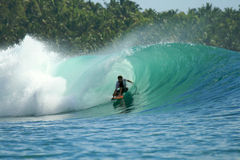 Surfer on green wave, Mentawai Islands, Indonesia Royalty Free Stock Photos