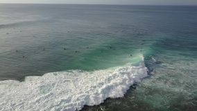 The surfer guy caught a wave. Blue ocean, beautiful waves, surfers are waiting for the wave. Extreme sport - Surfing. Surfers are waiting for a wave in the stock video