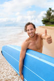 Surfer guy happy with surf surfing doing thumbs up. Surfer guy happy with surf surfing smiling doing thumbs up hand sign at camera after fun surf session in royalty free stock photo