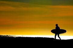 Surfer heading for the Pacific ocean Royalty Free Stock Photos