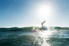 Surfer het opstijgen Stock Foto