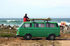 Surfer with his retro van. Surfer watching the ocean on top of his green vintage van Stock Photography