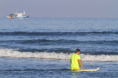 Surfer with his surfboard. Royalty Free Stock Photo