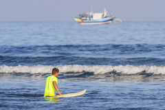 Surfer with his surfboard. Stock Photos