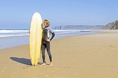Surfer with his surfboard Stock Photo