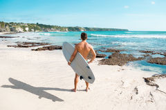 Surfer holding a surf board Royalty Free Stock Images
