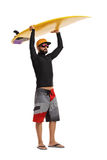 Surfer holding a surfboard above his head. Full length portrait of a surfer holding a surfboard above his head isolated on white background Royalty Free Stock Photography