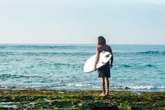 Surfer preparing to dive. The surfer is holding a surfboard on the Indian Ocean shore Stock Image