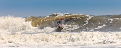 Surfer on huge waves Royalty Free Stock Photo