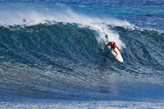 Surfer Ian Walsh Surfing Pipeline in Hawaii Royalty Free Stock Photos