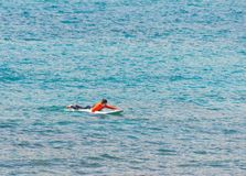 Free Surfer In The Sea Waiting For The Waves Royalty Free Stock Photo - 149880775