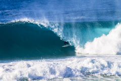 Surfer Rides Inside Hollow Wave Stock Images
