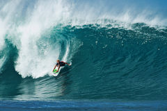Surfer John Florence Surfing Pipeline in Hawaii royalty free stock photo
