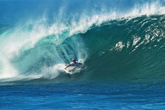 Surfer Jordy Smith Surfing Pipeline in Hawaii royalty free stock photos