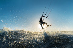 Surfer jumping at the sunset Royalty Free Stock Photography