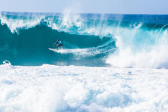 Surfer Kelly Slater Surfing Pipeline in Hawaii stock photos
