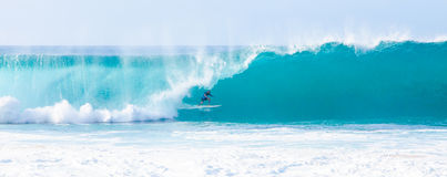 Surfer Kelly Slater Surfing Pipeline in Hawaii Royalty Free Stock Photography