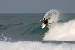 Surfer kickback on a wave Stock Image