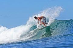 Surfer Kirby Fukunaga surfing in Hawaii royalty free stock photo