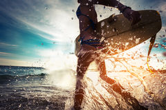 Surfer lady with board Royalty Free Stock Photos