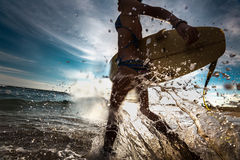 Surfer lady at the sea Royalty Free Stock Photography