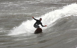 Surfer in Levanto. Between surfer beach waves of Levanto La Spezia Liguria stock photo