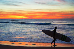 Surfer with longboard Stock Photos