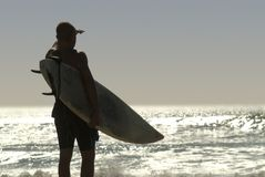 Surfer looks out Stock Photography