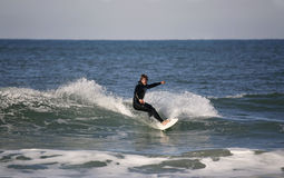 Surfer making a forehand Stock Images