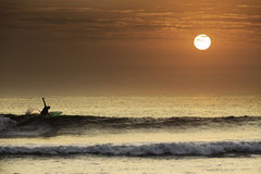 Surfer making a perfect turn in a beautiful sunset in northern Peru. South America Royalty Free Stock Photography