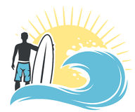 Surfer man on the beach Stock Photo