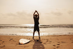 Surfer man fitness on the beach Stock Photos