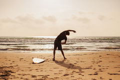 Surfer man fitness on the beach Royalty Free Stock Images