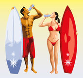 Surfer man and girl drinking Royalty Free Stock Photography