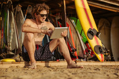 Surfer man with pc tablet Stock Photo