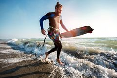 Surfer man with surf board on the beach. Summer sport activity. Portrait of surfer man with surf board on the beach. Summer sport activity stock photography