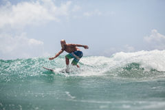 Surfer man surfing on waves splash actively Royalty Free Stock Images