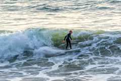 Surfer at Manhattan Beach, California. Surfing the waves in a wetsuit Royalty Free Stock Photos